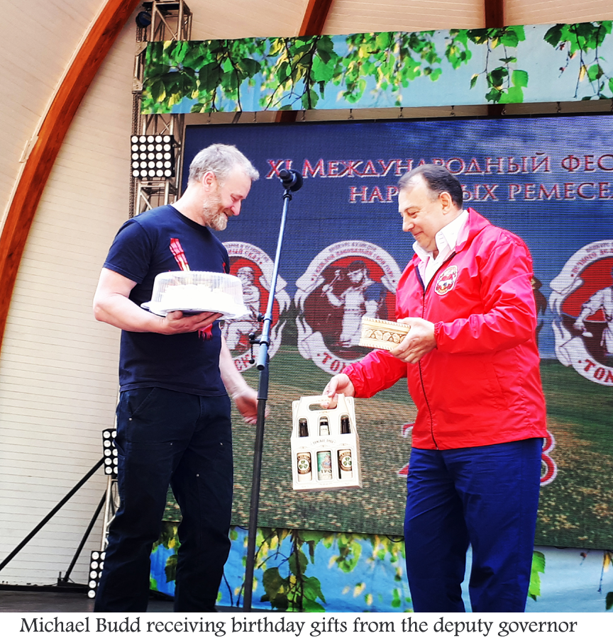 Michael receiving birthday gifts from the Deputy Governor.